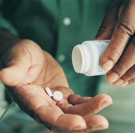 Medication in hand.