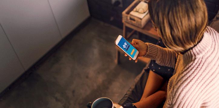 Woman using the HorizonBlue App on her smartphone.