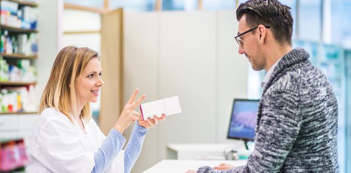 Man at a pharmacy filling his prescription.