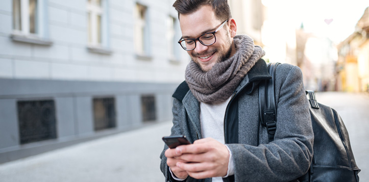 man on street using app on mobile phone