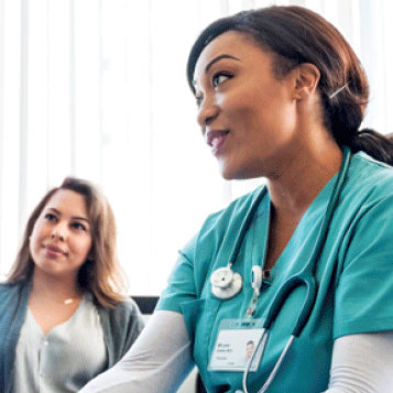 A nurse speaking with a patient.